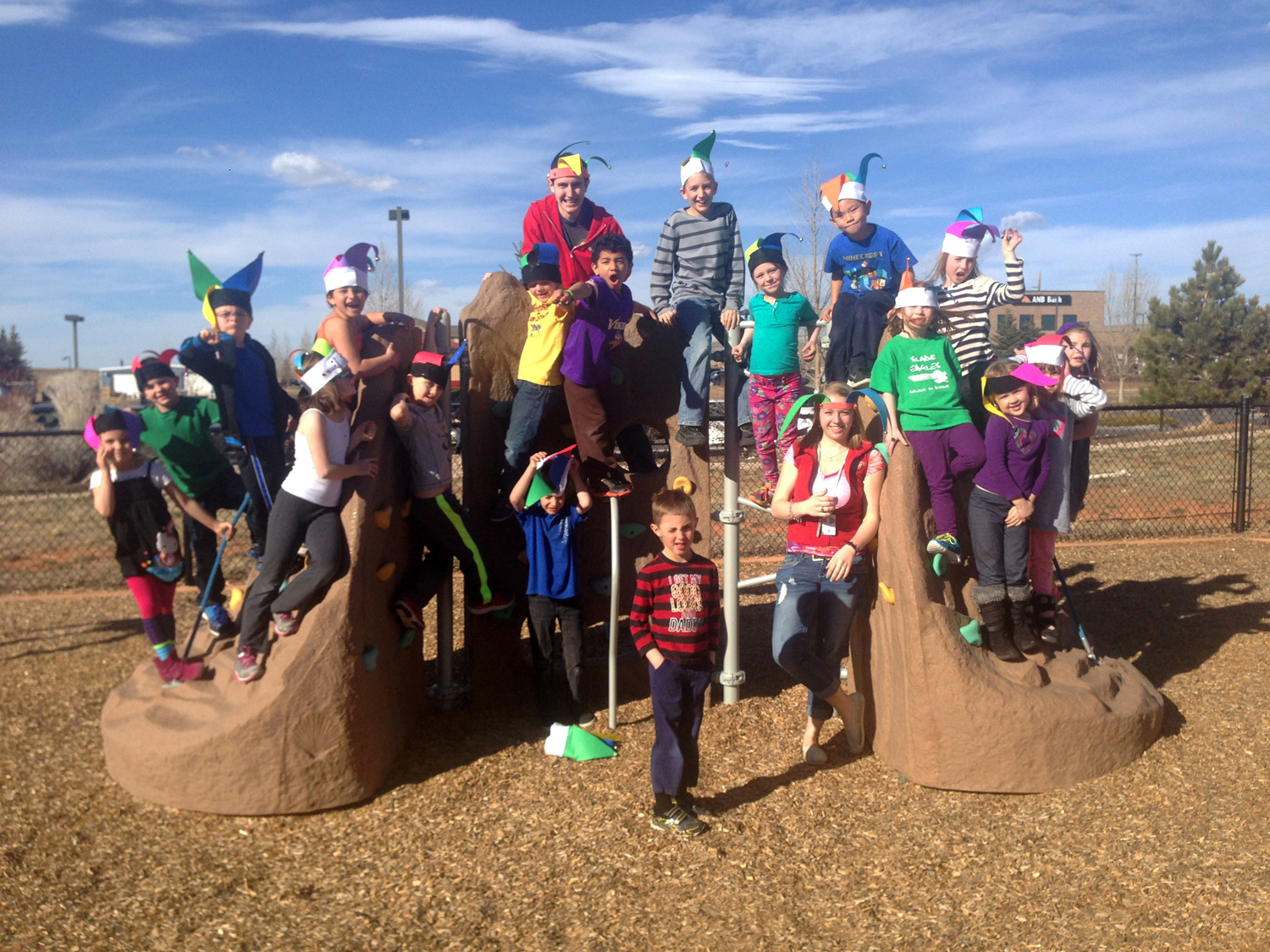 SACC photo on playground with hats small.jpg